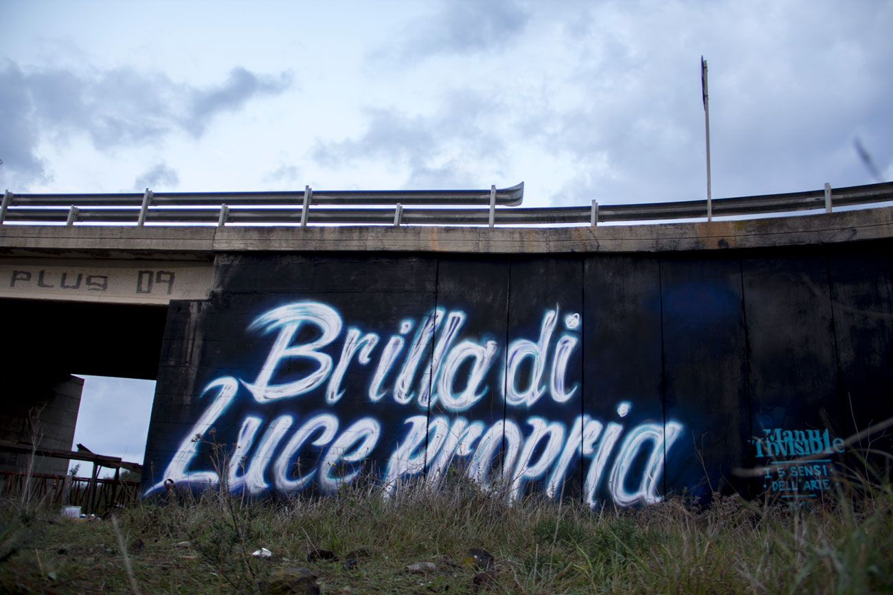 ''Brilla di luce propria'' Spray quartz paint on wall 6 x 12 m Cagliari 2016