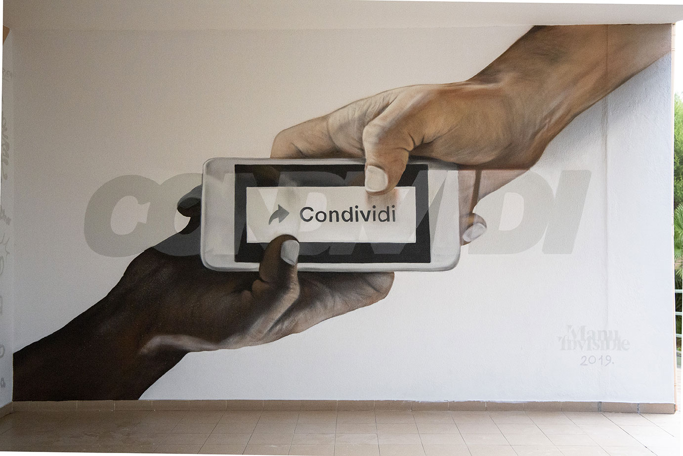 ''Condividi'' Spray and quartz paint on wall 3 x 4,5 m Senorbì 2019